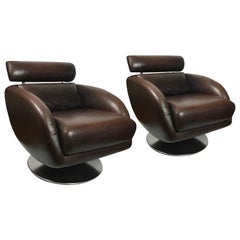 Pair of Chateaux D'ax Brown Leather Swivel Armchairs