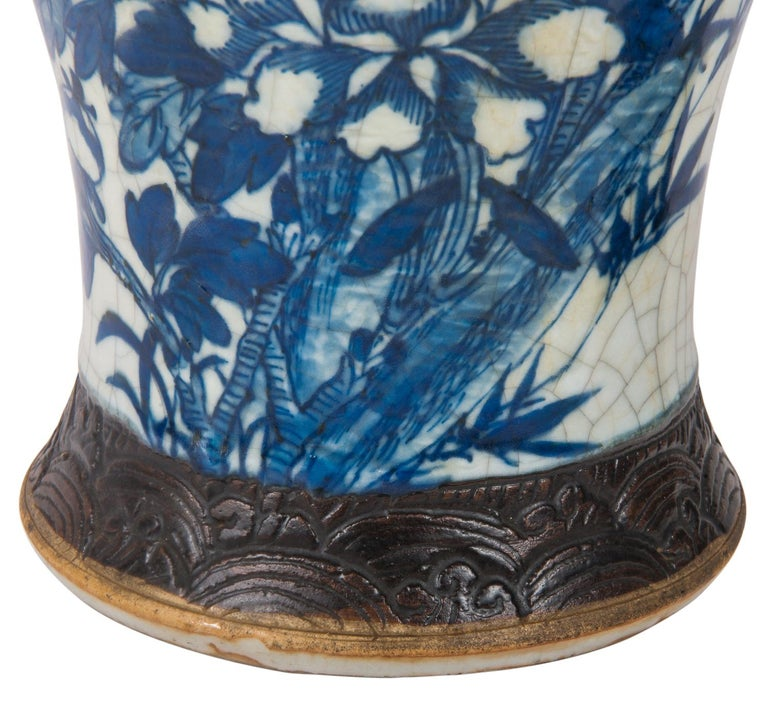 A good quality pair of Chinese blue and white crackleware vases. Each with hand painted exotic flowers birds and foliage. We can have this pair of vases converted to lamps within the price if needs be.