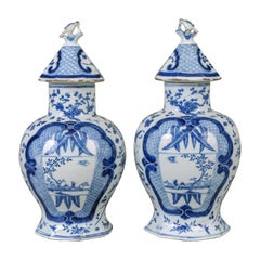 Pair of Chinese Blue and White Vases with Conical Lids