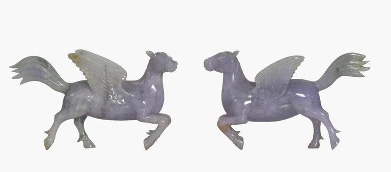 Pair of Chinese carved jade winged horses  Measures: Height 4 in. (10.16 cm.), Width 7 in. (17.78 cm.)