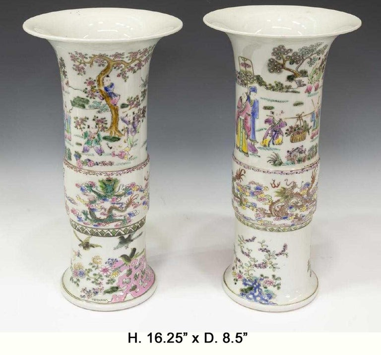 Beautiful pair of Chinese Famille rose porcelain beaker vases. Early 20th century and possibly earlier. The flared rim is over an enamel decorated cylindrical body depicting scenes of children playing with dragons in the clouds. Underglazed six