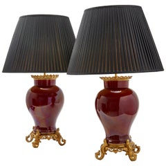 Pair of Chinese Oxblood Porcelain Lamps with Bronze Mounts, circa 1890