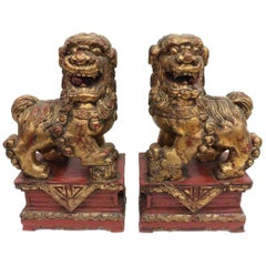 Pair of Chinese Parcel-Gilt Red Foo Lions
