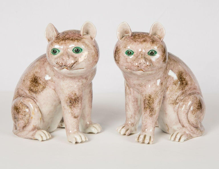 WHY WE LOVE THEM: Who can resist those faces? We are delighted to offer this captivating pair of light brown Chinese cats which date to the second half of the nineteenth century. Qing-era potters skillfully captured the psyche of the cats with crisp