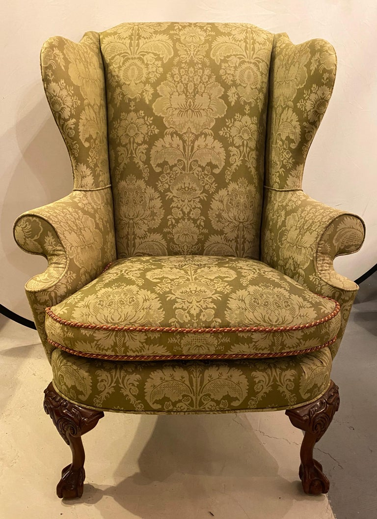 Pair of Chippendale ball and claw wingback chairs with fine scalamandre upholstery. These incredibly upholstered arm, lounge or wingback chairs are simply stunning. The high back style and flair of the Chippendale era come alive in these hard to