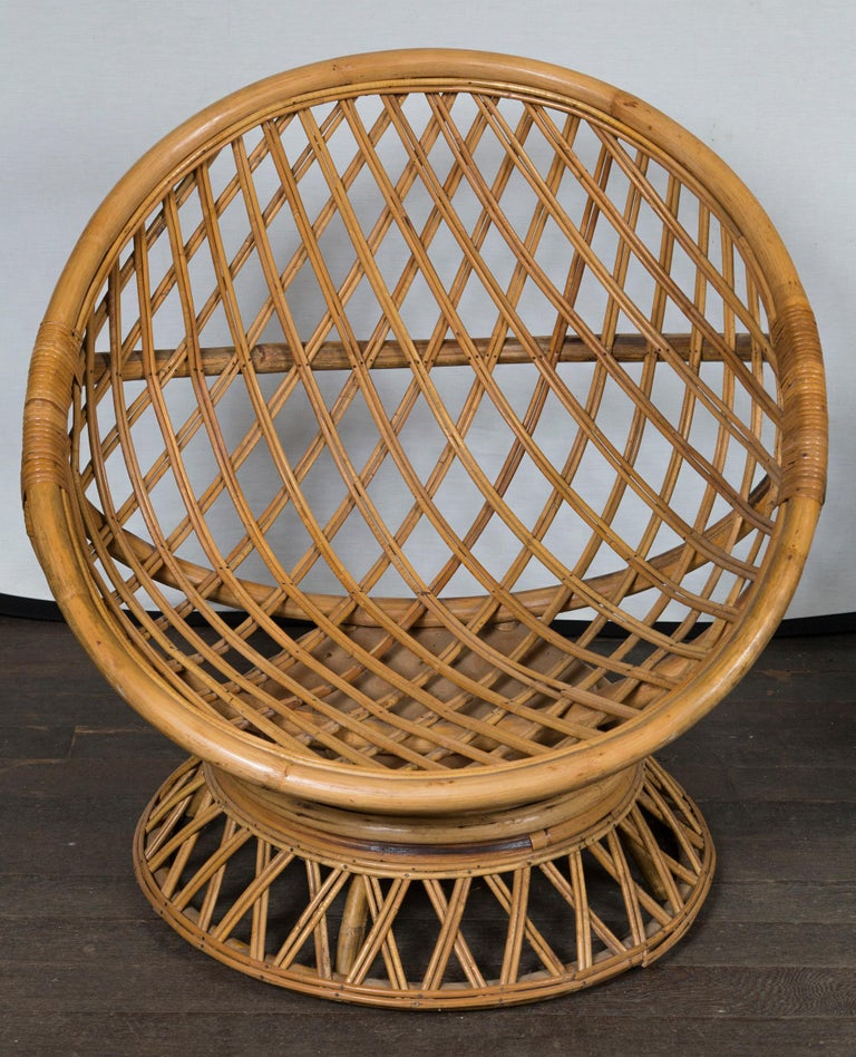 A very glamorous pair of round rattan saucer chairs. Seat height (without a cushion) is 12 inches. Chairs rock.