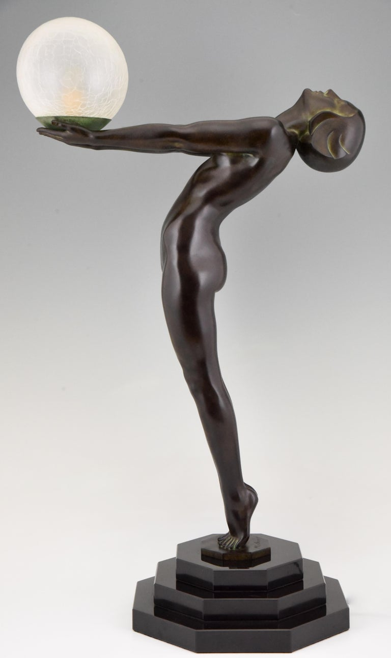 Patinated Pair of Clarté Art Deco Style Lamps Max Le Verrier Nude with Globe 84 cm 33 inch For Sale