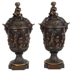 Pair of Classical 19th Century Bacchus Lidded Bronze Urns