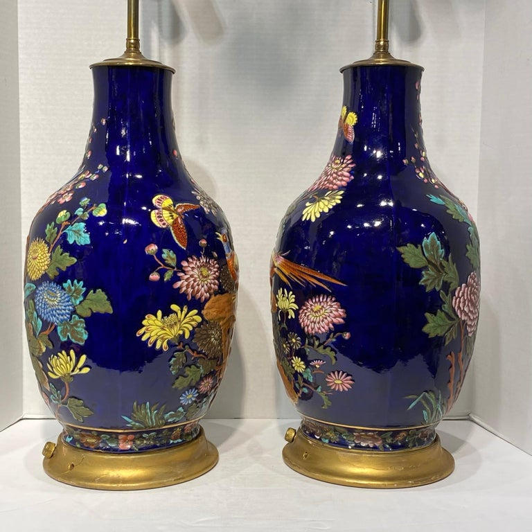 Pair Colorful Enameled Porcelain Table Lamps with Bird and Flowers Motifs In Good Condition For Sale In New York, NY
