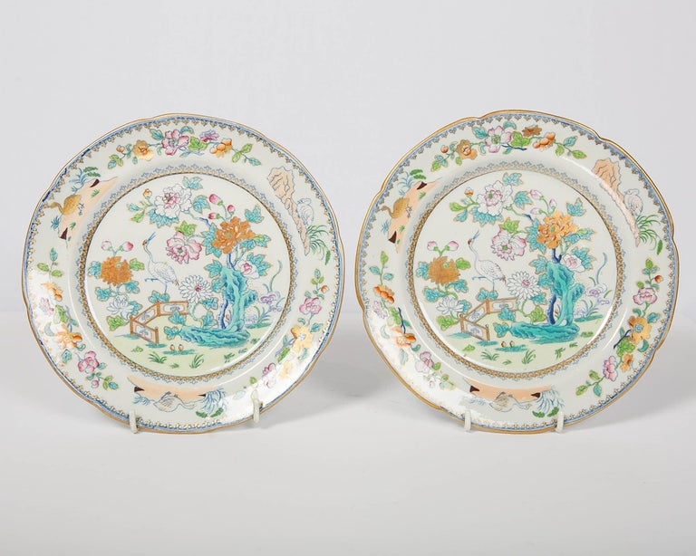 We are pleased to offer this pair of colorful chinoiserie decorated Davenport plates made in England, circa 1820. Davenport was known for the beauty and originality of its designs. This pair of dishes have hand painted details over a printed design.