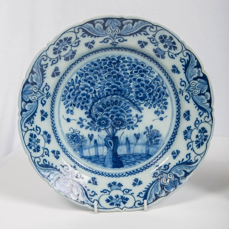 We are pleased to offer this pair of Dutch delft blue and white chargers in the Theeboom pattern. They show a tea plant with fan shaped leaves and flowers. This is one of the most beautiful patterns created for delft chargers in the 18th century.