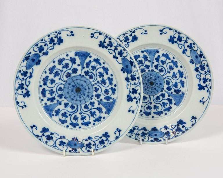 We are excited to offer this exquisite pair of Dutch Delft blue and white chargers made circa 1770. This plate features a beautifully symmetrical design showing delicate flowers and scrolling vines. Dimensions: 10.5