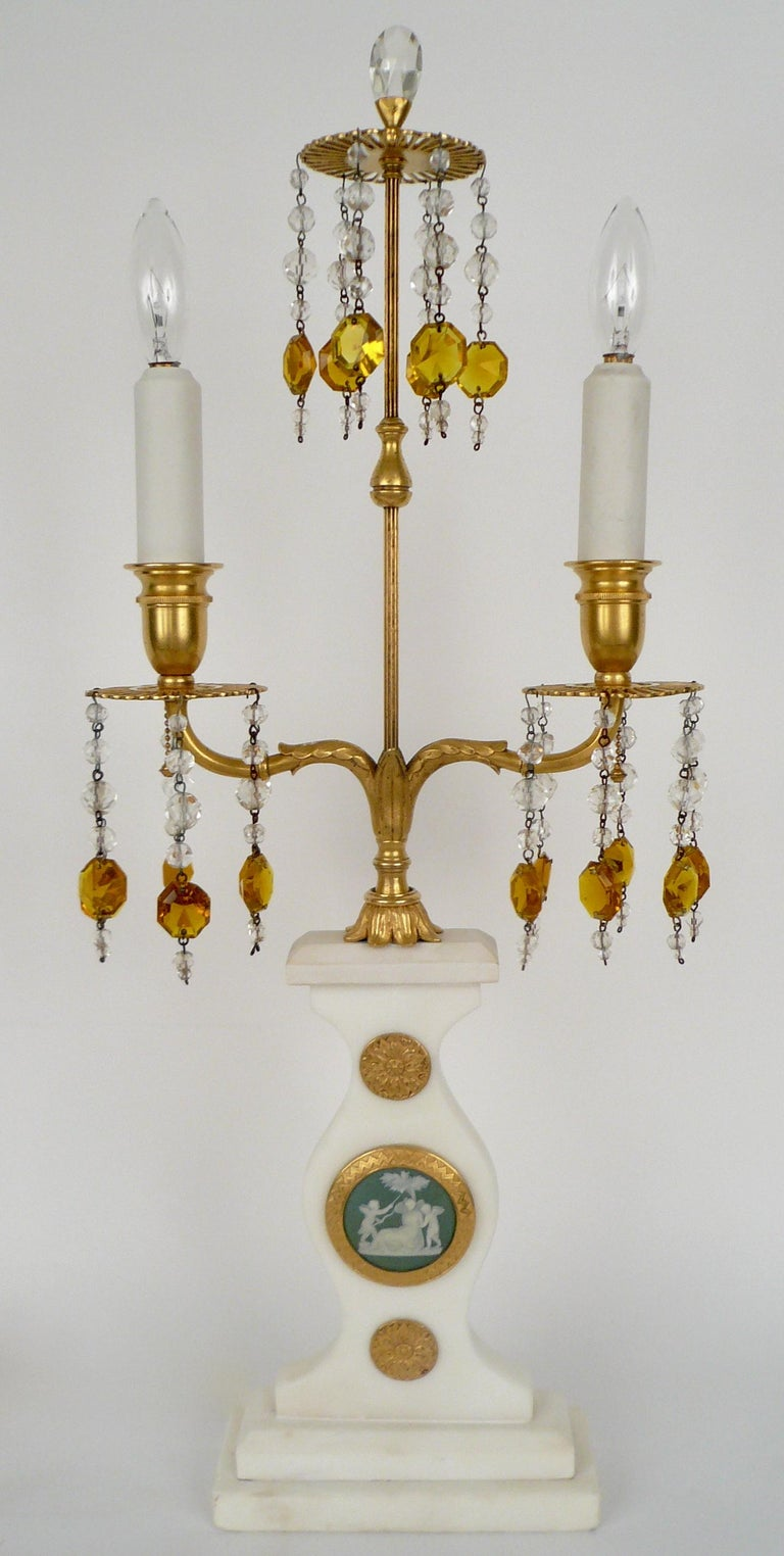 This fabulous pair of Caldwell lamps feature Wedgwood jasperware plaques and gilt bronze mounts on Carrara marble.