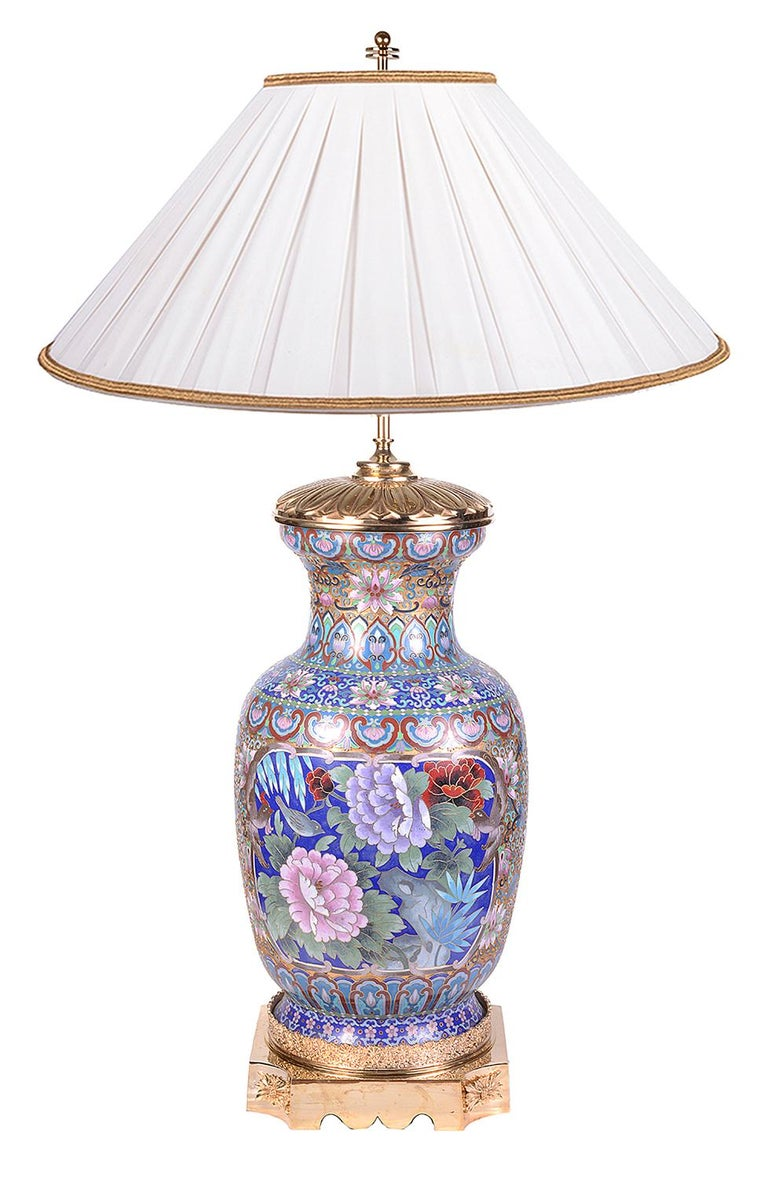 A very impressive pair of early 20th century Chinese Cloisonne enamel vases / lamps, each with wonderful bright coloured floral and classical motif decoration and mounted with gilded ormolu mounts.