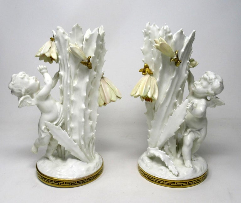 Victorian Pair of English Moore Brothers Porcelain Cream Gilt Cherub Vases Centerpieces For Sale