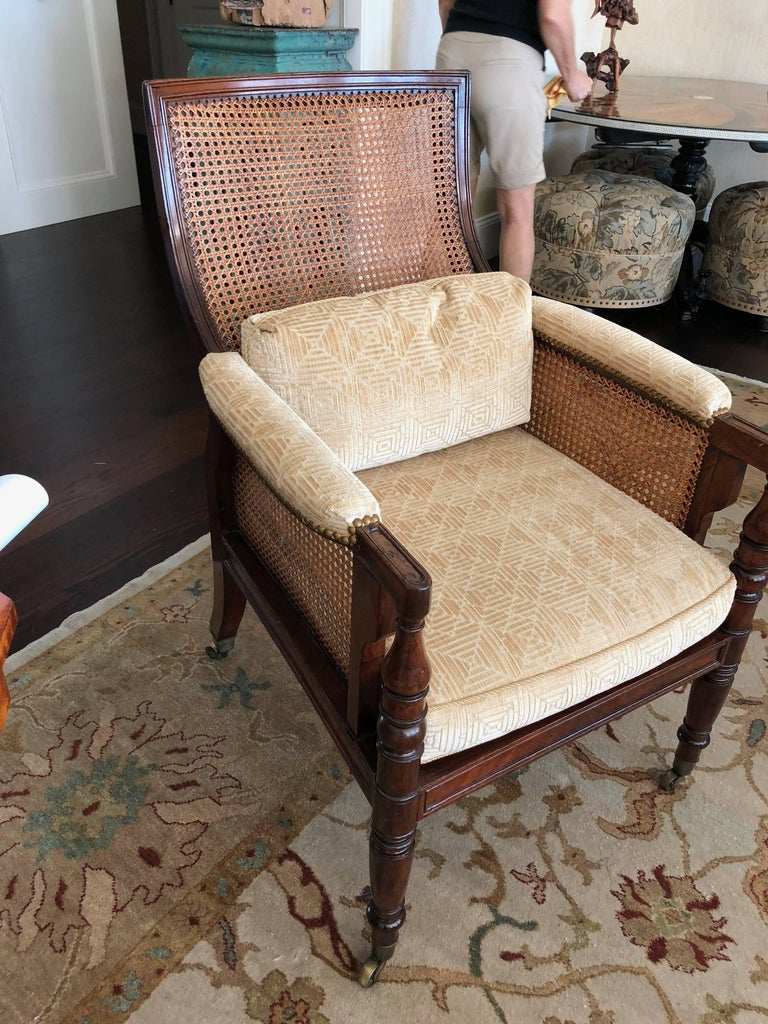 Hand-Carved Pair of English Regency Caned Library Bergere Armchairs For Sale