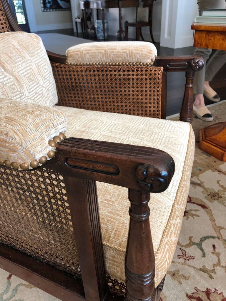 Mahogany Pair of English Regency Caned Library Bergere Armchairs For Sale