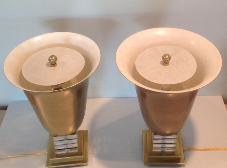 Decorative pair of Frederick Cooper Lucite and brass urn form lamps.