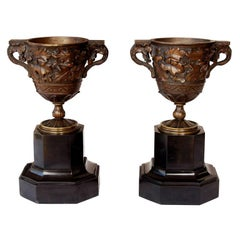 Pair French 19th C.  Bronze Decoartive Urns on Marble Bases
