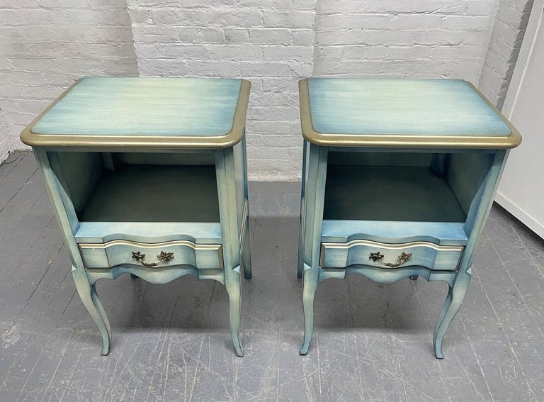 Pair French antique style painted nightstands. The nightstands are nicely painted, have single pull out drawers and an open space for storage.