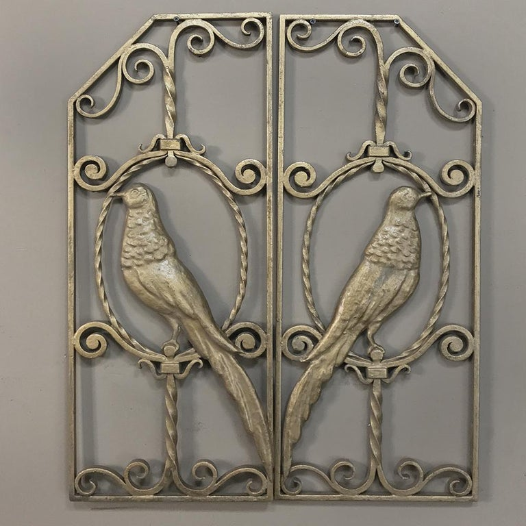Pair French Art Deco gilded wrought iron gates are ideal for a quaint courtyard or interior accent, and feature an avian theme, circa 1930s Measure: 28 H x 23 W (Each 11.5W).