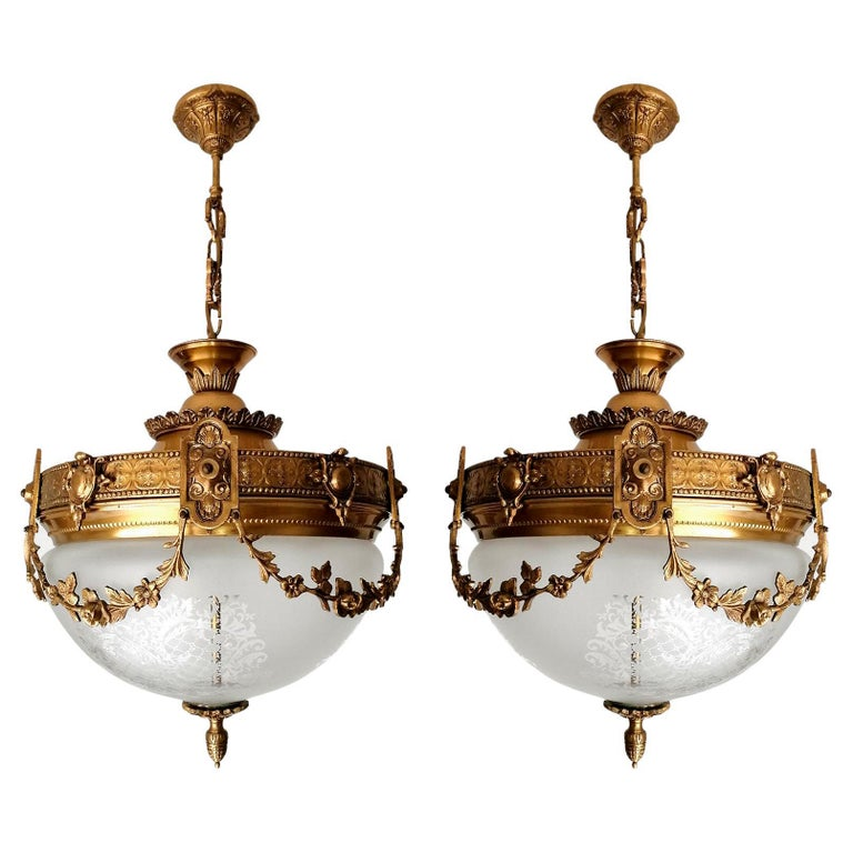 A pair of wonderful gilt bronze and etched-glass two-light ceiling fixture decorated with Fine ornaments and garlands, France, early 20th century. In very good condition - original etched-glass shades without damages, bronze with beautiful