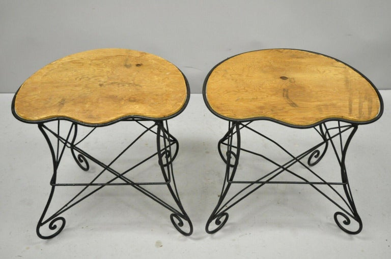 Pair of French Art Nouveau style stool bench seats with scrolling wrought iron frame, early 20th century. Measurements: 19