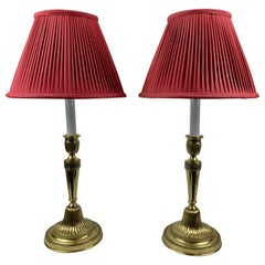 A Pair of French Bronze Candlestick Lamps with Hand Sewn Red Silk Shades