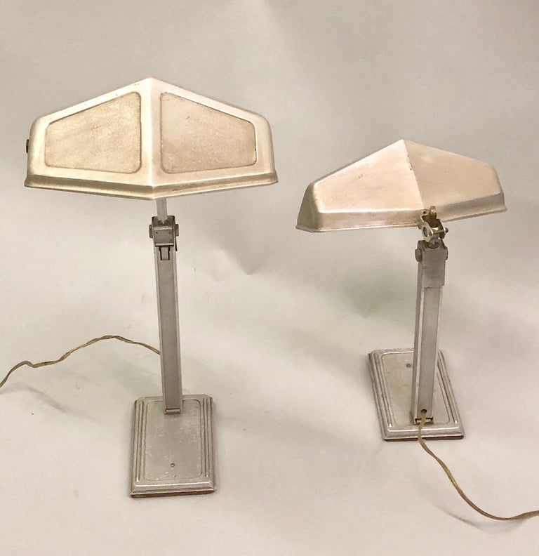Two French early modern desk or table lamps in aluminum with movable and adjustable diffusers by Pirette. 