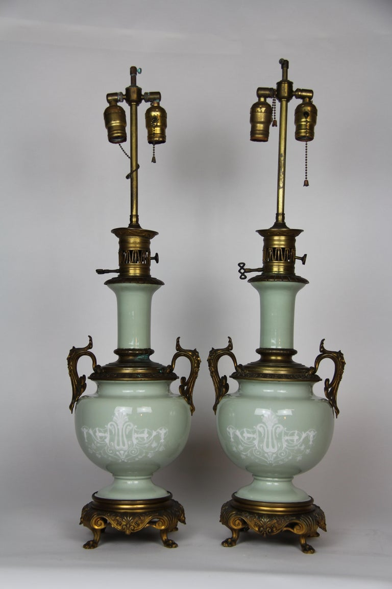 Louis XVI French Gilt Bronze Mounted Double-Sided Pate Sur Pate Celadon Ground Lamps, Pair For Sale