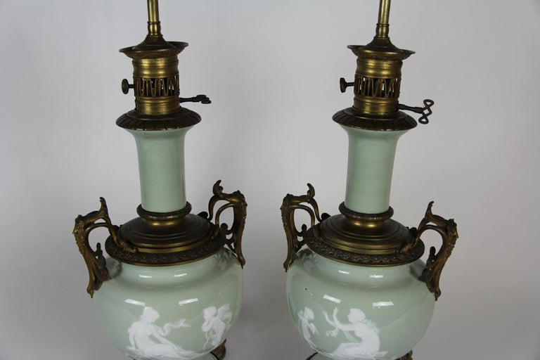French Gilt Bronze Mounted Double-Sided Pate Sur Pate Celadon Ground Lamps, Pair In Good Condition For Sale In New York, NY