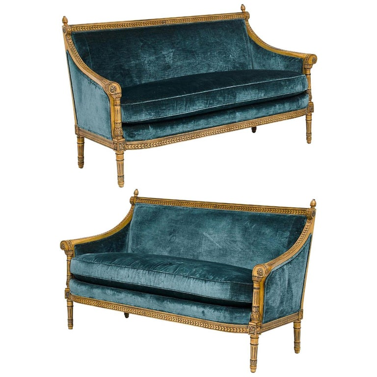 Pair of Louis XVI Style Carved and Laqué Gilded Bergère Settees or Loveseats For Sale