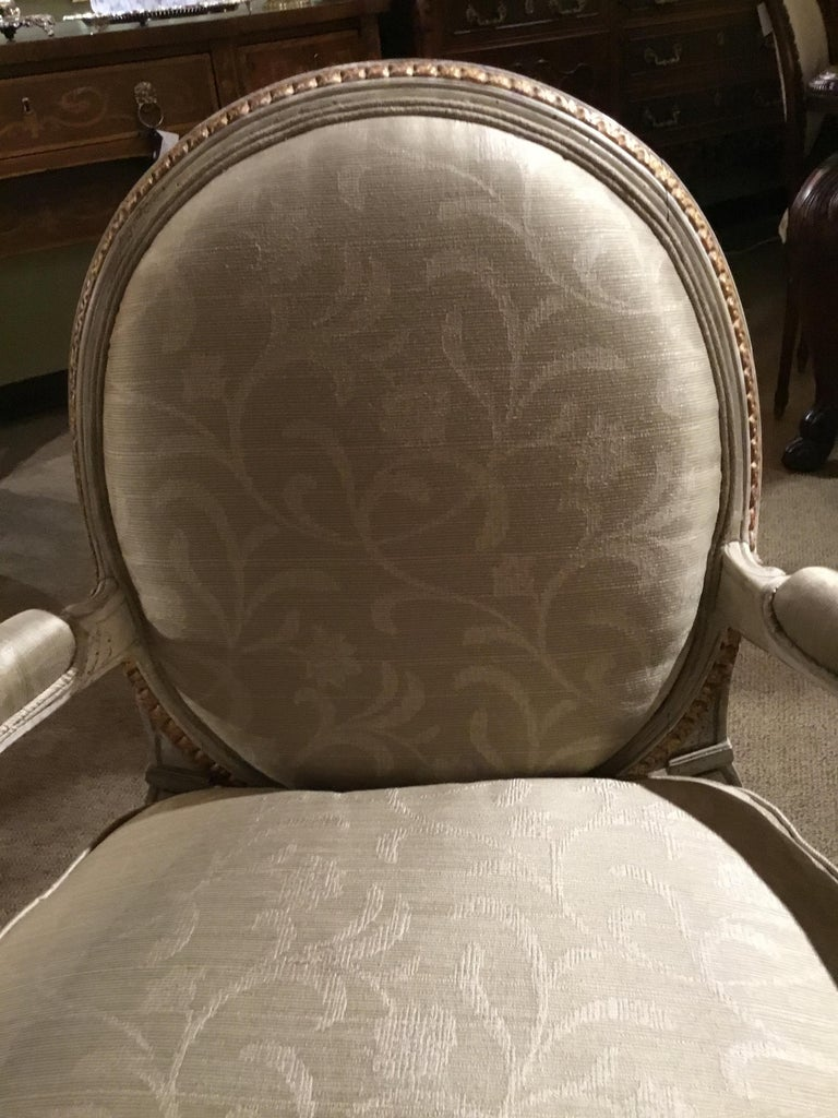 Polychromed Pair of French Louis XVI Style Parcel Paint and Parcel-Gilt Chairs/Fauteuils For Sale