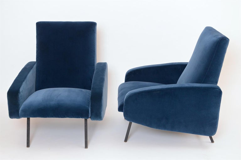 Pair of re-upholstered French armchairs. Metal black lacquered legs Upholstered in a blue cotton velvet.