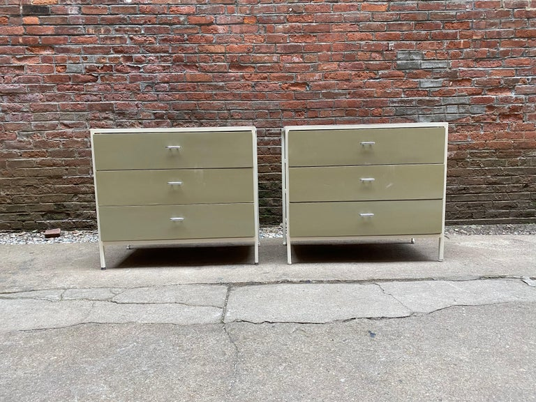Pair of George Nelson for Herman Miller steel frame and laminate dressers. Three deep drawers with white steel frames and a