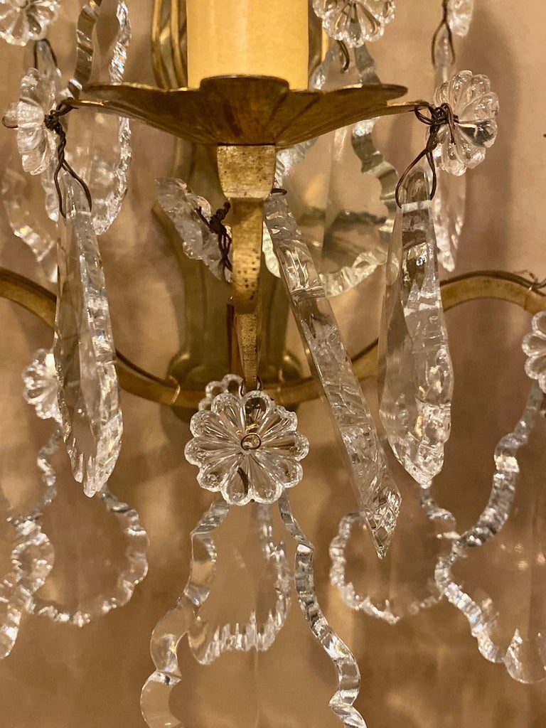 Gilt Bronze and Crystal Three-Light Wall Sconces French Early 20th Century, Pair In Good Condition For Sale In Stamford, CT