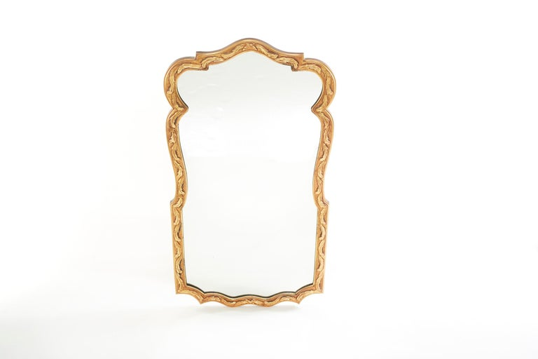 Beautiful pair of gilt wood framed beveled hanging wall mirror in a geometric shape with hand carved design details motif. The mirror is in good condition. Minor wear consistent with age / use. The gilt wood frame measure 48 inches high X 26 inches
