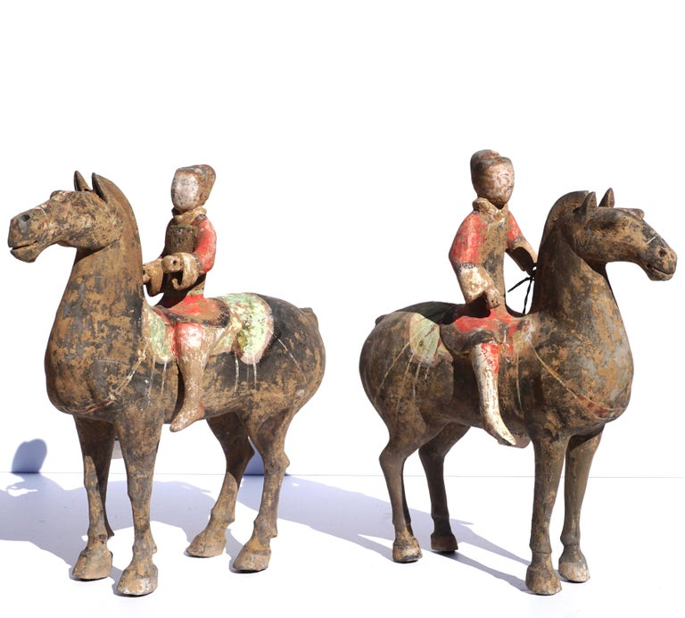 A wonderful pair of Ex Sotheby's painted Polychrome Equestrian Horse and Riders made from gray pottery, Presents beautifully and guaranteed authentic with provenance and COA.   Measures: Height 11.5 inches and width 11 inches  Condition: