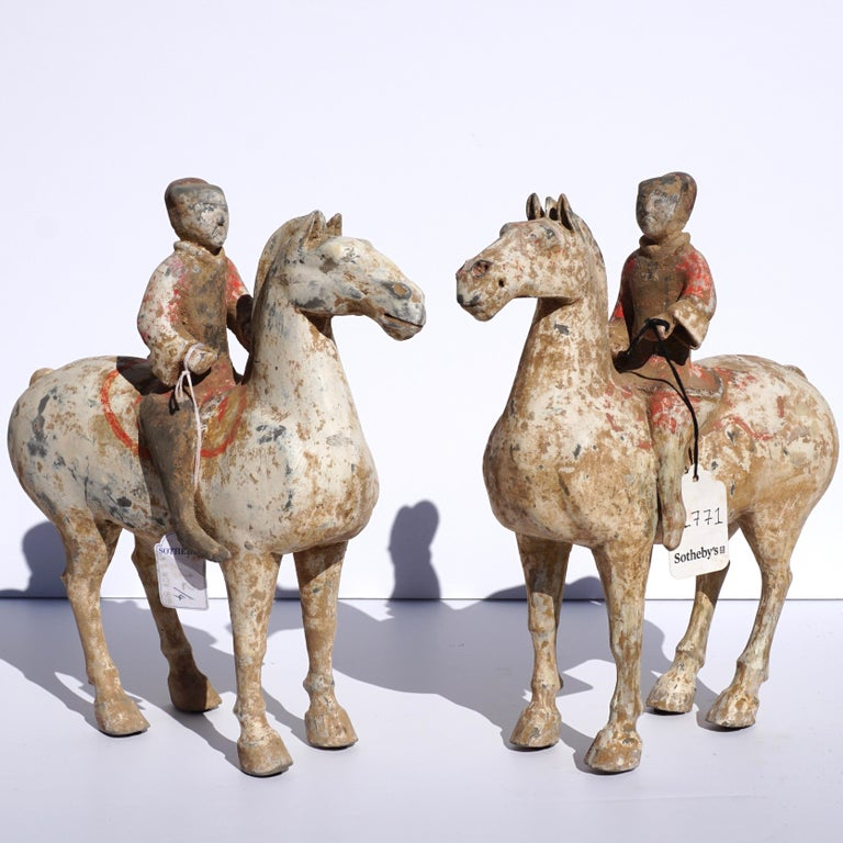 A wonderful pair of Ex Sotheby's painted Polychrome equestrian horse and riders made from gray pottery, presents beautifully and guaranteed authentic with provenance and COA.  Measures: Height 11.5 inches and width 11 inches  Condition: Possible