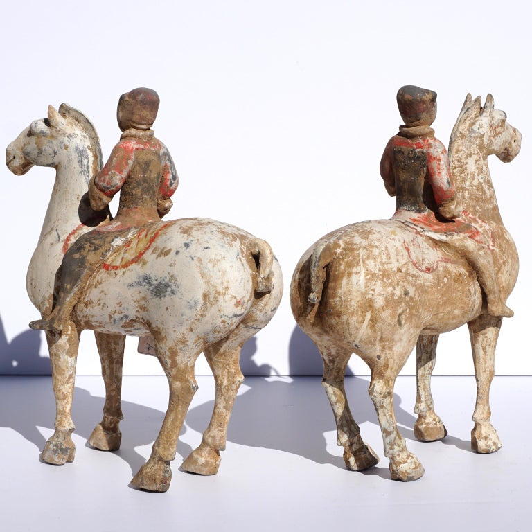 Polychromed Pair of Han Dynasty pottery Horses and Equestrian Riders For Sale