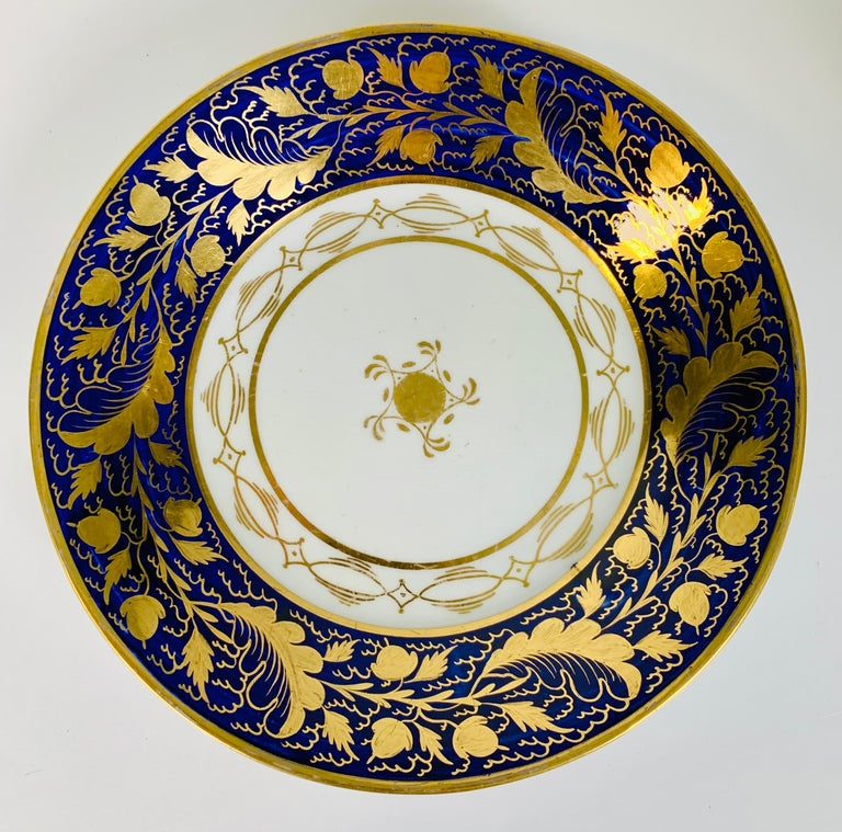 An exquisite pair of gold on blue New Hall porcelain dishes made in England circa 1790. The gilding was done by hand. The design of these dishes features gold decoration of acorns and oak leaves on a deep cobalt blue ground (see