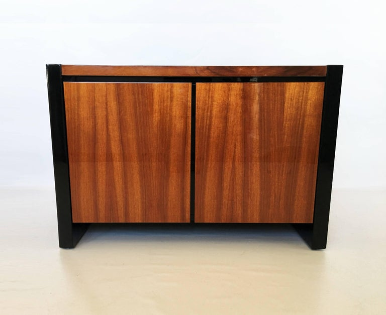 Stunning pair of Henredon Koa wood and black lacquer nightstands or side tables from the Elan Collection by Henredon. Featuring Hawaiian koa wood with black lacquer trim. Beautiful grain of the koa wood contrasted against the black lacquer. Each