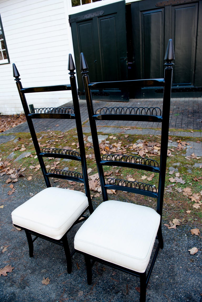 Pair of tall ladder back European side chairs. Finials are painted black as the rest of the chairs. Measures: Seat: 17.5 inches wide, 17 inches deep, 19 inches high.