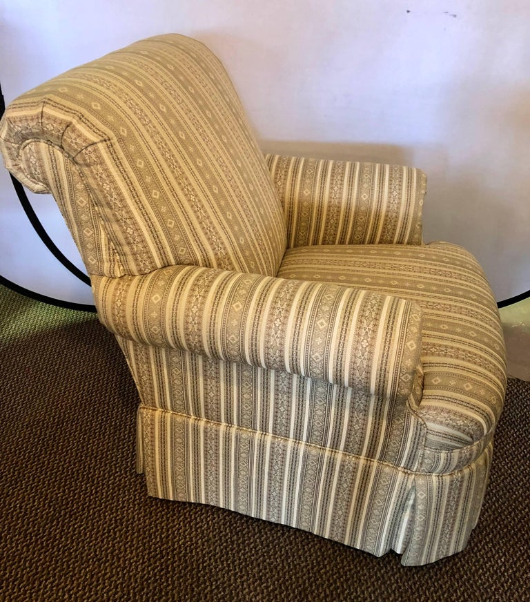 Pair of Hollywood Regency style custom overstuffed arm / lounge chairs in fine fabric. Direct from a Long Island Gold Coast Mansion. Sharp, sleek and clean.