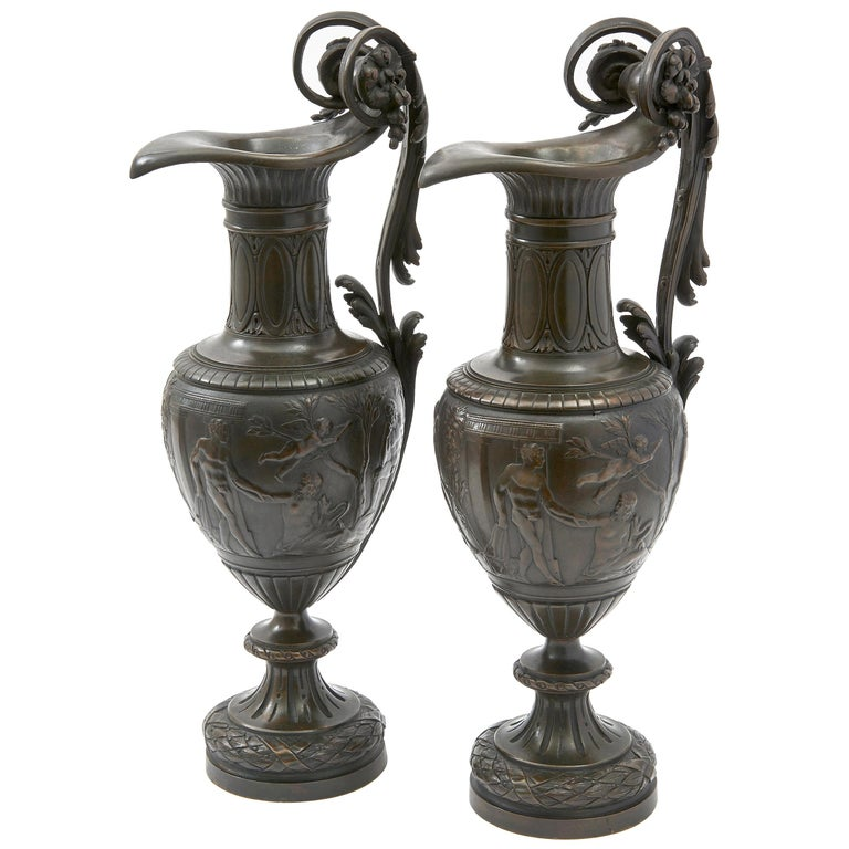 Pair of Italian Bronze Ewers with Scenes of Classical Antiquity, circa 1870