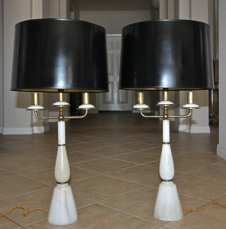 Pair of Gio Ponti style 1940s Italian alabaster candelabra lamps with brass arms and fittings. Newly restored and rewired with full range dimmer socket and rayon covered French style cord. Shades not included for photography purposes only.