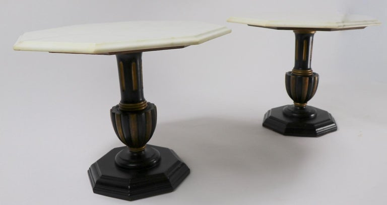 Stylish pair of side or end tables each having an octagonal marble top, supported by a polychrome (gold and black) wood base. Both are ain good, original condition showing only minor cosmetic wear normal and consistent with age (1950s-1960s). Made