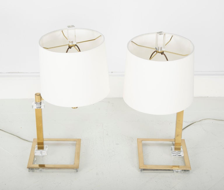 Both stylish and practical, this is a great looking pair of Mid-Century Modern table lamps. The adjustable swing arms make these perfect for a desk or pair of end tables or bedside tables.
