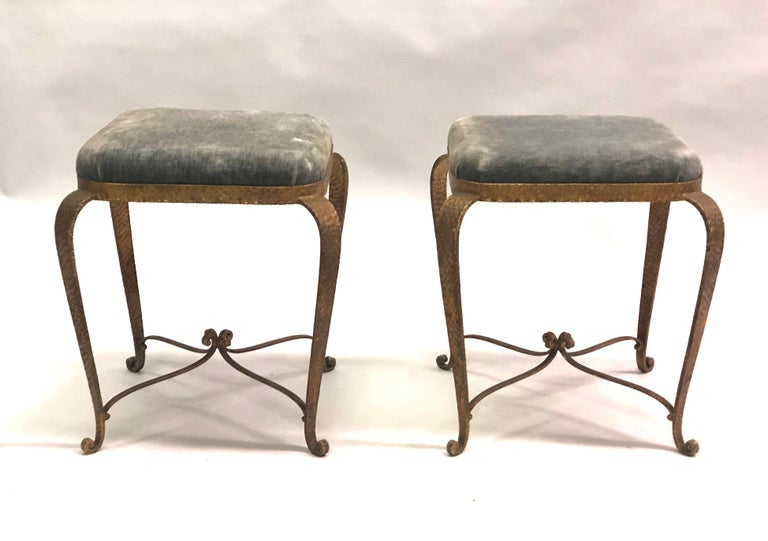 Pair of Italian Mid-Century Modern neoclassical hammered, wrought iron and gilt benches or stools by Pier Luigi Colli. Original upholstery.