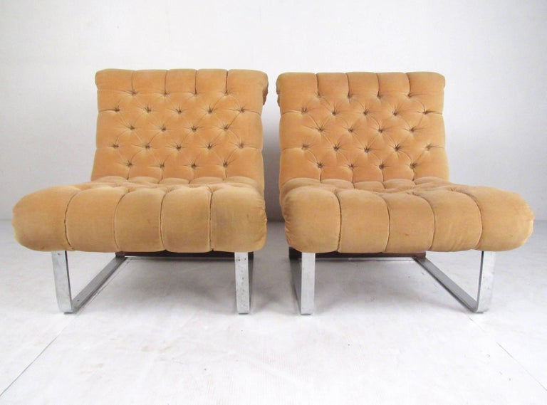 This pair of Mid-Century Modern lounge chairs features heavy chrome cantilever base, tufted vintage fabric, and unique Italian modern design. Sculpted seats make an elegant vintage modern addition to home or business seating, while the